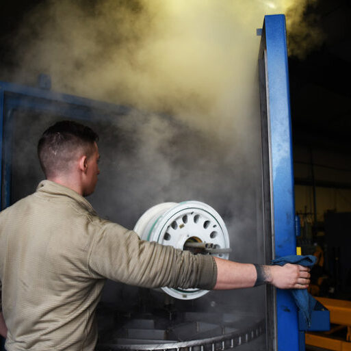 Senior Airman Jacob Ramsey, 48th Equipment Maintenance Repair and Reclamation journeyman, opens a newly acquired parts washer at Royal Air Force Lakenheath, England, Dec. 3, 2018. The washer is a new innovation gained to enhance the readiness capabilities of the 48th EMS Repair and Reclamation section. (U.S. Air Force photo by Airman 1st Class Shanice Williams-Jones)